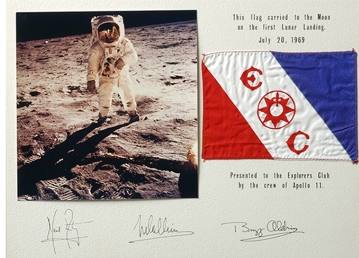An expedition gets a flag from the Club_This one was on the moon.